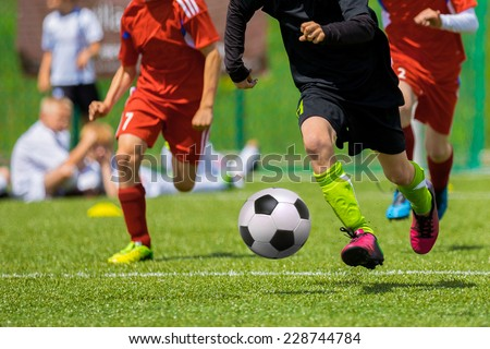 Football match for children. Training and football soccer tournament - stock photo