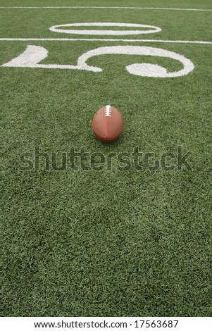 Football near the fifty with room for copy - stock photo