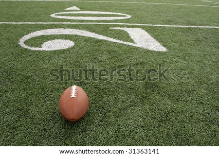 Football near the Twenty yard line - stock photo