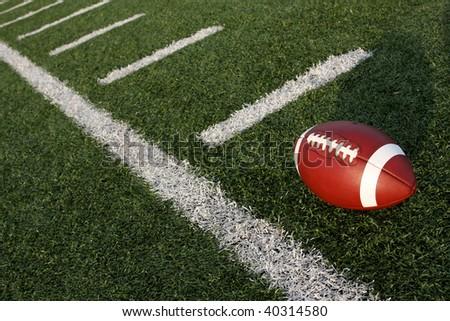Football near the yard lines - stock photo