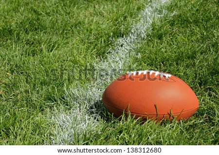Football Near Yardline American Football on Natural Grass Field - stock photo