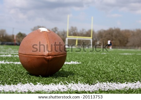 Football on a field - stock photo