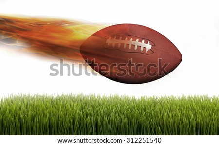 Football on fire speeding through the air. - stock photo