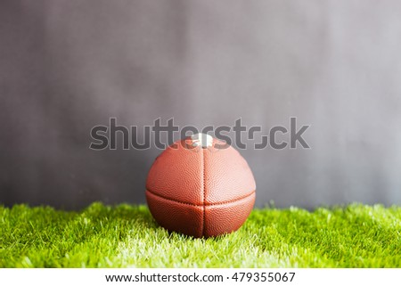 Football on grass and black background