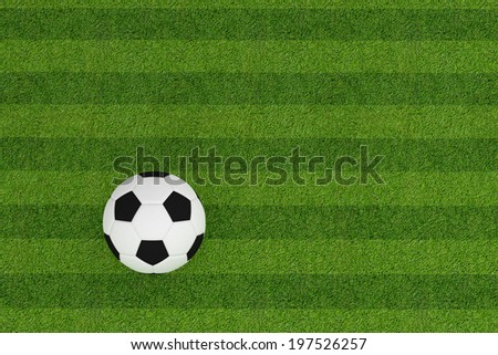Football on grass field background