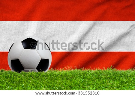 Football on grass field with wave flag of Austria - stock photo