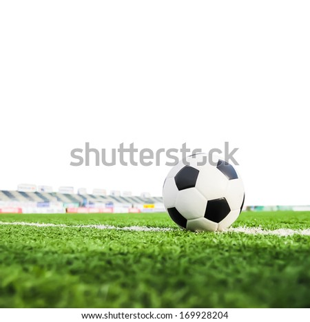 football on green grass isolated - stock photo
