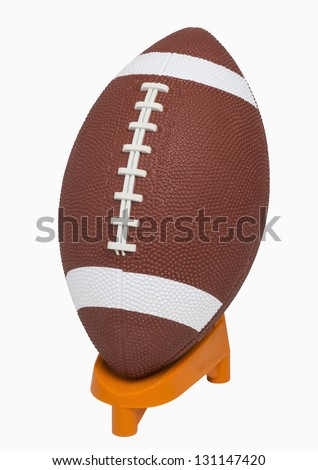 Football on tee, isolated on white, includes clipping path