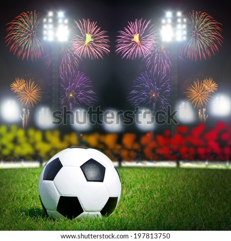 Football on the field with stadium and fire work - stock photo