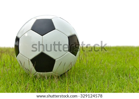 football or soccer ball on green grass field isolate on white background. This has clipping path. - stock photo