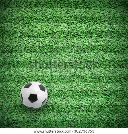 Football or soccer ball on green lined field