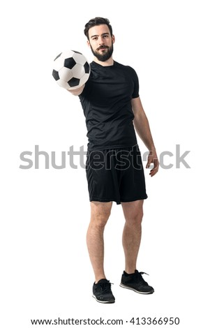 Football or soccer player holding and offering ball to a camera. Challenge concept. Full body length portrait isolated over white background.  - stock photo