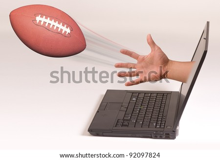 Football out of the Computer Screen. - stock photo