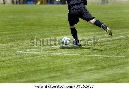 Football player beats on ball - stock photo