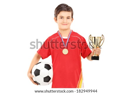 Football player holding a golden cup isolated on white background - stock photo