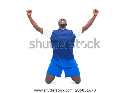 Football player in blue celebrating a win on white background