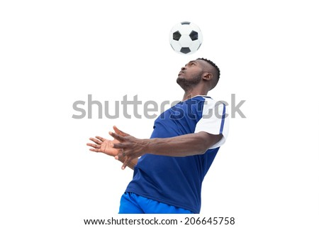 Football player in blue heading ball on white background