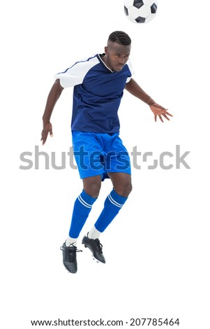 Football player in blue heading ball on white background - stock photo