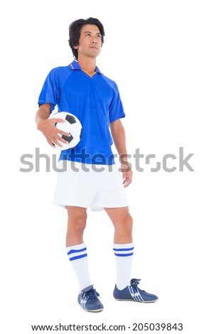 Football player in blue holding the ball on white background