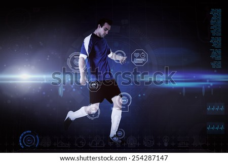 Football player in blue kicking against blue dots on black background