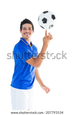 Football player in blue spinning ball on white background