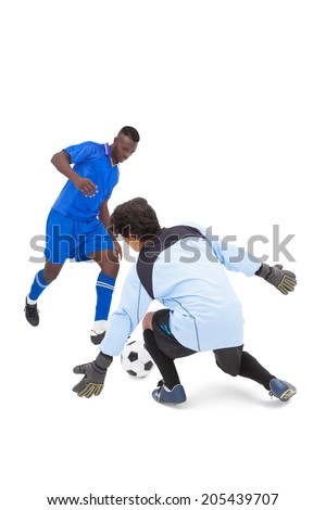 Football player in blue striking at keeper on white background