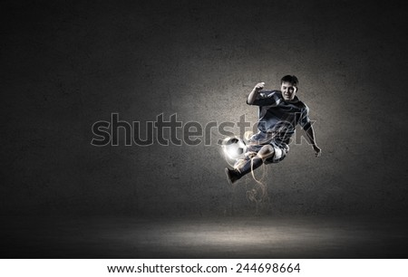 Football player in high jump taking ball