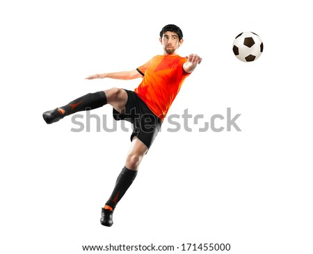 football player in orange shirt striking the ball at the white background - stock photo