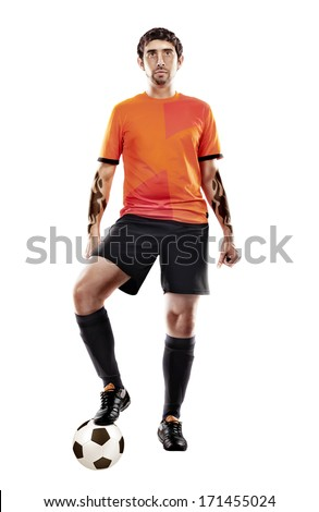 football player in orange shirt with ball at the white background - stock photo