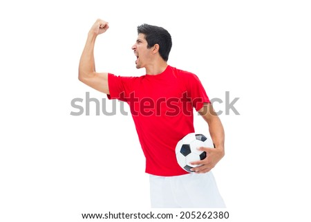Football player in red holding ball and cheering on white background