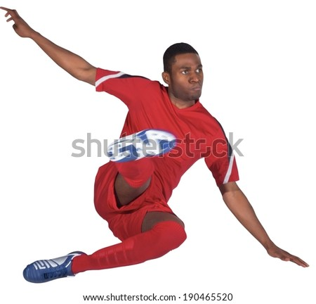 Football player in red kicking on white background