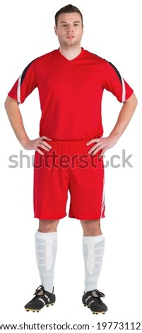 Football player in red looking at camera on white background