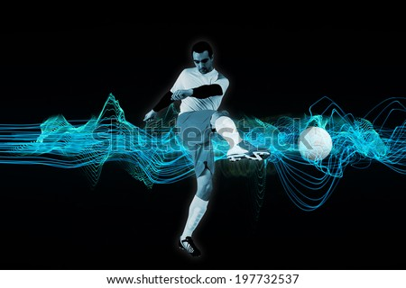 Football player in white kicking against abstract blue glowing black background