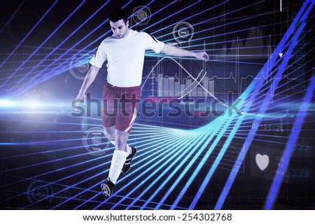 Football player in white kicking against black background with blue grid - stock photo