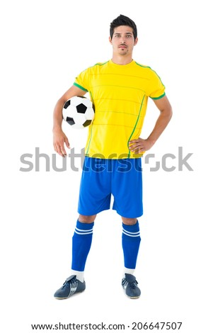 Football player in yellow holding the ball on white background