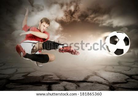 Football player kicking a ball - stock photo