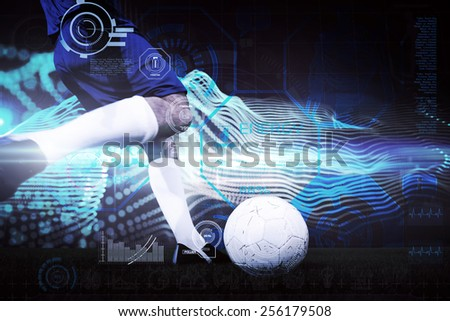 Football player kicking ball against abstract blue glowing black background - stock photo