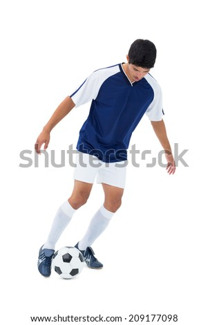 Football player kicking the ball on white background - stock photo