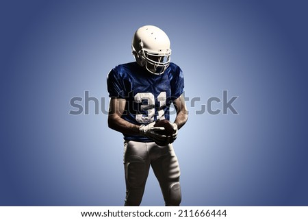 Football Player on a Blue uniform, on a Blue background.