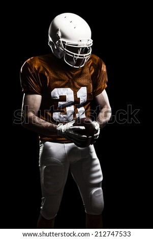 Football Player on a Orange uniform, on a black background.