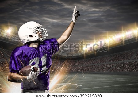 Football Player on a purple uniform celebrating on a Stadium.
