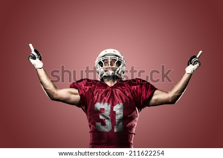 Football Player on a Red uniform celebrating on a red background.