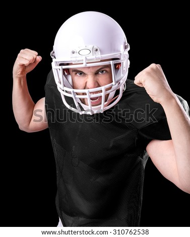 Football Player on black isolated on black background