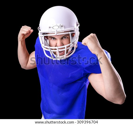 Football Player on blue uniform isolated on black background