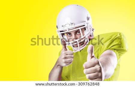 Football Player on blue uniform isolated on yellow background