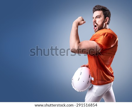 Football Player on red uniform on blue background