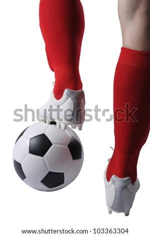 Football player on using foot keep and stop a football in the game - stock photo