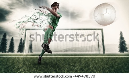 Football player shooting the ball and decompose . Splatter and dispersion effect