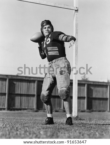 Football player throwing ball - stock photo