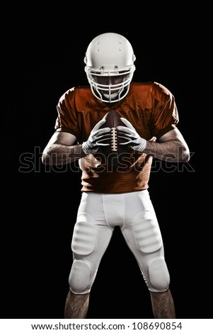 Football player with a ball in the hands, looking to the ball. - stock photo
